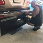 Fitting mud flaps to the Landcruiser